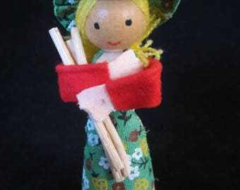 Wood Christmas Ornament-of little farm girl dressed in green attire with matching hat. Made in Taiwan. Sweet collectible Christmas Ornament!