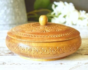 carved round wood box with engraved design and lift off lid
