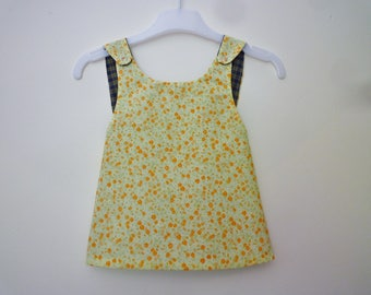 Tunic/baby dress with straps crossed in the back, reversible