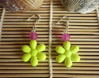 Pierced earrings, neon yellow flower and transparent purple bead.