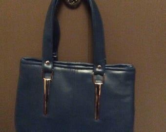 Beautiful handbag made from navy blue vinyl fabric