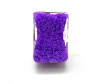 Rectangular globe ring filled with purple sand