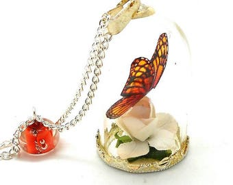 Orange butterfly and bead glass globe necklace