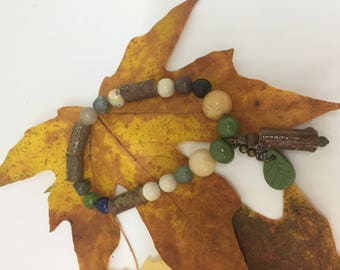 Hand Crafted Stretch bracelet with wood, stone and clay components
