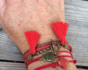 Red and bronze cuff bracelets