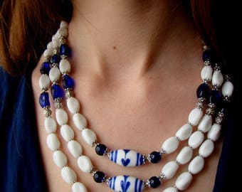 Sale White and blue glass beads necklace. Hand made beads with blue leaves. 3 strands white necklace