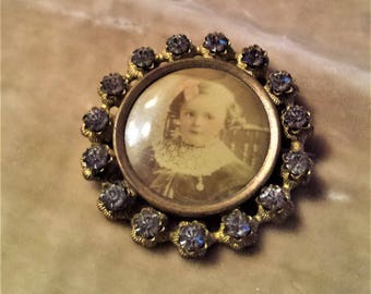 Gold Filled Locket Brooch with a Celluloid Film Picture