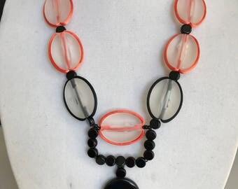 A happy black, white, and orange necklace