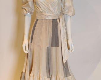 A vintage 1970s Paul Louis Orrier Silk Gown pleated skirt S - M