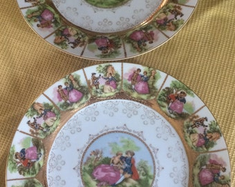 ROYAL VIENNA marked and numbered pair of fabulous dinner plates trimmed in gold