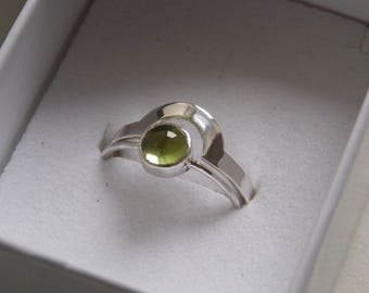 2 rings in silver stackable with peridot stone.