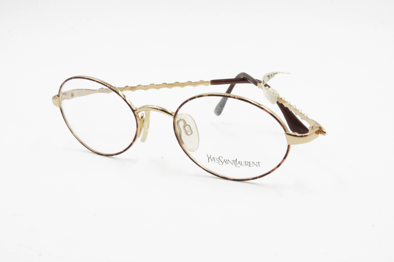cb65752eb85 Yves Saint Laurent YSL frame eyeglasses Mod. 4124 Y119 round oval lenses