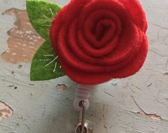 Red rose flower ID badge reel holder retractable clip