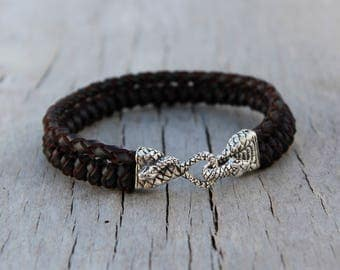 Leather and sterling silver handmade bracelet.Sterling silver lock.Braided authentic leather bracelet.Unique work.Cobra sterling silver lock