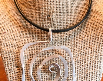 Stunning hand made silver pendant in a very modern bold design