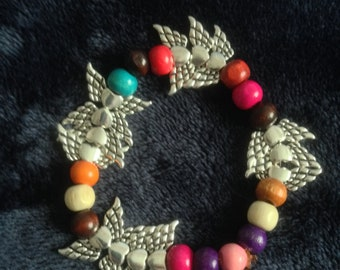 Bracelet of multi coloured  beads and four silver charms