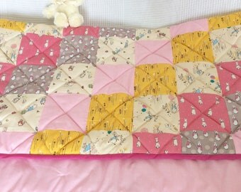 Peter rabbit baby girl quilt: pink