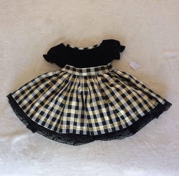 Black Velvet top.black,grey and gold plaid skirted dress,Size 2.