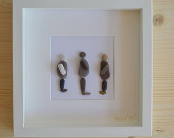 Beach pebble figures standing - frame