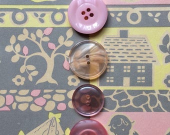 Eight pearly pastel coloured plastic buttons - 12 mm and 22 mm