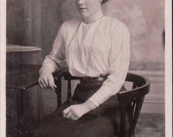 Studio Photograph of a Young Woman Sitting on a Chair. - Postcard - Blank - 1913