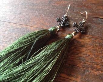 Green silk tassel earrings. Small black cross earrings with forest green silk tassels.