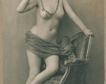 Young Woman Blues | French Erotica | 1920's Nude Flapper Leans Upon Parlor Chair | Silken Sash | Beaded Necklace | Risqué Antique Postcard |