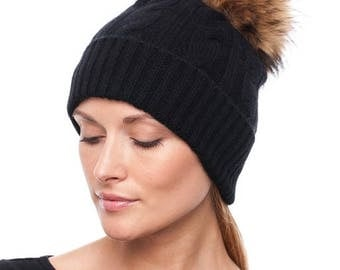 Handmade knitted black cashmere hat with raccoon fur pom pom