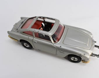 Corgi 007 Aston Martin DB5 Made in GT Britain Vintage Gray Metal Spy Car with Red Interior and James Bond Figurine Driving Collectible
