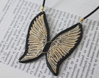 Fashion necklace, bib, two golden Angel Wings type polymer clay