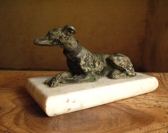 Art Deco cast iron greyhound with a brass collar on a marble base, 1920s