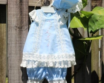 Dress for girl. with Shorty bombache and hood in soft blue hand embroidery