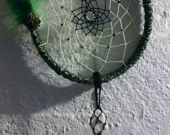 Handmade beautifully crocheted green and black dream catcher with green feathers and green and white stones hanging from bottom! Unique gift