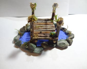 Fairy garden pond with bridge and frog