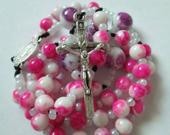 pink rosary,pink and white rosary,rosary,rosaries,catholic rosaries,corded rosaries,rosaries with cord rosary made with cord knotted rosary