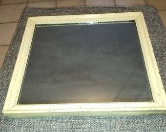 Old molded wood frame rectangular mirror