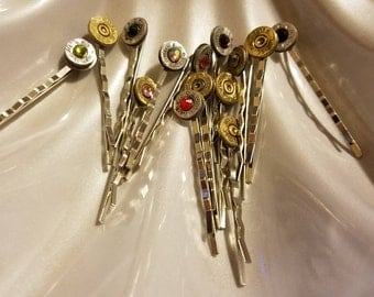 Many different colors of bling and some without bling of bobby pins  and caliber casings all recycled