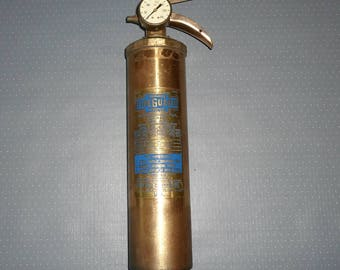 Antique classic fire extinguisher made of brass with manometer.