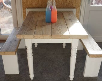 Rustic farmhouse dining table with reclaimed wood top and two benches