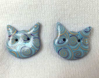 Sewing buttons. 2 buttons cats: two blue cats.