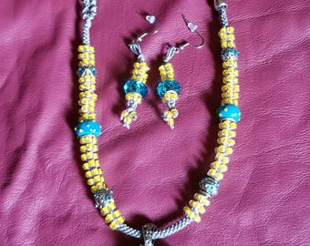 Yellow boxed beaded necklace with silver n blue highlights. Matching earrings
