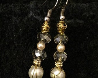 Pearl Earrings with Gold detailing.
