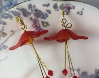 Beautiful boho chic gold plated, red lucite harebell earrings with yellow bead centres and drop Swarovski bicones.