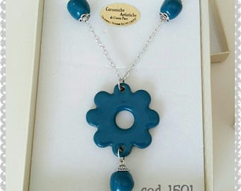 Necklace with pendant and ceramic balls