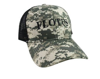 FLOTUS Typography First Lady of the United States Melania Trump Style Black Embroidery on an Adjustable Structured Digital Camo Trucker Cap