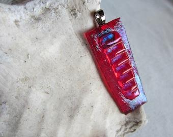 Iridescent red fused glass pendant