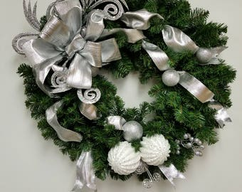 Silver and White Christmas wreath with curly sprays on a Christmas greens wreath base