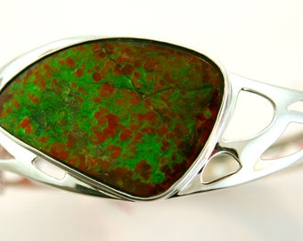Large Sterling Silver Bangle with Canadian Ammolite in Green and Orange hues.