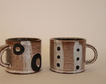 Pair of Decorated Stoneware Cups