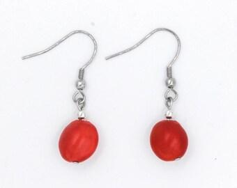 Orange Caconnier seed earrings
